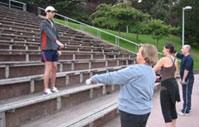 Boot camp weights - lifting weights in outdoor fitness bootcamp at Kezar Stadium in SF